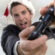 Businessman playing video game — Stock Photo