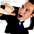 Young man singing into microphone — Stock Photo