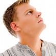 Young man looking upwards — Stock Photo #1364035