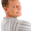 Stock Photo: Smiling male looking backwards