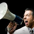 Manager shouting through megaphone — Stock Photo