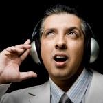 Adult businessman listening music — Stock Photo