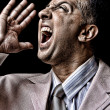Aged businessmna shouting loud — Stock Photo