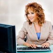 Pretty woman at work — Stock Photo