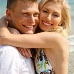 Carefree couple on the beach — Stock Photo #1365585
