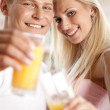 Couple drinking orange juice — Stock Photo