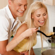 Royalty-Free Stock Photo: Couple having romance in kitchen