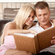 Stock Photo: Couple sharing album