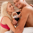 Stock Photo: Couple sharing wine in bed