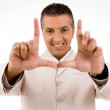 Stock Photo: Happy man making gestures