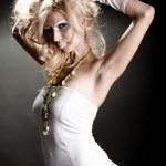 Fashion shot of beautiful young woman — Stock Photo