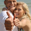 Couple smiling with thumbs-up — Stock Photo #1368196