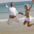 Young couple jumping high — Stock Photo