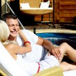 Young couple by pool — Stock Photo
