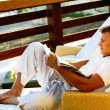 Young man reading — Stock Photo