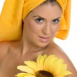 Gorgeous beauty in towel with sunflower — Stock Photo #1368510