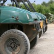 Quad bikes in queue - Stock Photo