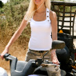 Stock Photo: Beautiful young lady on ATV