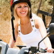 Stock Photo: Pretty young lady on atv