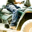 Close-up of sportsman riding his quad — Stock Photo