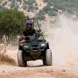 Rider on his four wheel ATV — Stock Photo