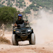 Stock Photo: Rider on his four wheel ATV
