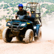 Quad rider driving rash - Stock Photo