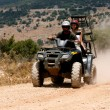 A four-wheeler ATV runs through trail — Stock Photo
