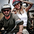 Stock Photo: Happy young couple on ATV