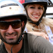 Couple wearing safety helmet, enjoying ride - Stock Photo