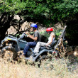 Stock Photo: ATV climbing, couples enjoying ride