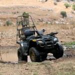 Military four wheeler in the desert — Stock Photo #1368715