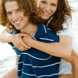 Piggyback on beach — Stock Photo #1368952