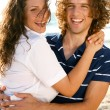 Young couple embracing — Stock Photo #1369031