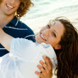 Young teen holding lady in his arms — Stock Photo #1369053