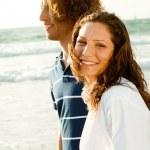 Couple walking down the beach — Stock Photo