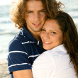Adorable couple embracing at beach — Stock Photo #1369128