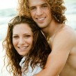 Stock Photo: Adorable couple embracing at beach