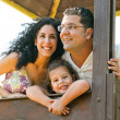 Foto Stock: Smiling portrait of family