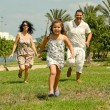 Daughter running ahead of her parents — Stock Photo