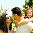 Happy young family outdoors — Stockfoto