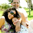 Foto Stock: Daughter having fun with her parents