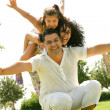 Happy family having fun outdoors — Stock Photo #1369424