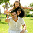 Foto Stock: Family with thumbs up