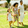 Family walking outdoors — Stock Photo