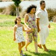 Family walking outdoors — Stock Photo #1369444