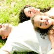 Couple lying down with daughter — Stock Photo