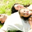 Couple lying down with daughter - Stock Photo
