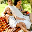 Stock Photo: Jolly family resting in shade
