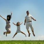 Fly happy family on blue sky — Stock Photo